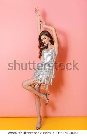 若い女性 明るい ドレス 画像 かなり 笑みを浮かべて ストックフォト © deandrobot