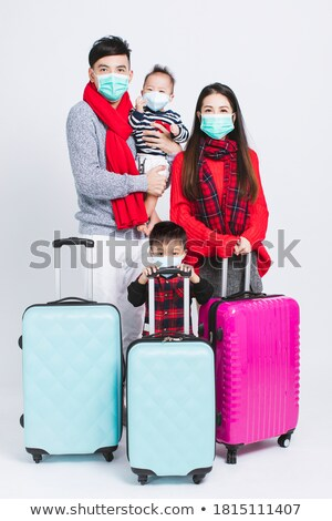 Family vacation lifestyle. Happy woman in medical mask stand at viewpoint. Look at beautiful beach u Stock photo © galitskaya