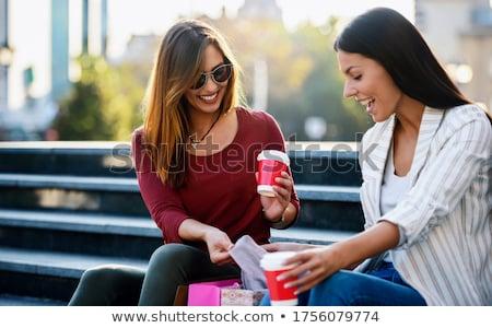 kettő · gyönyörű · nők · fiatal · nők · megnyugtató · kanapé - stock fotó © iko