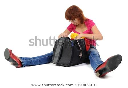 Caucasiano mulher olhando saco isolado Foto stock © Qingwa
