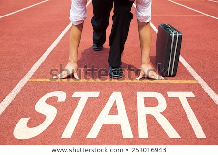 Businessman getting ready for race Stock photo © HASLOO