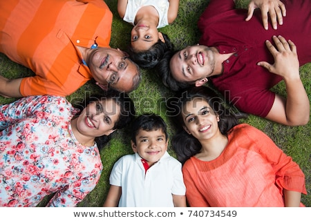 happy family lying in the ground stock photo © get4net