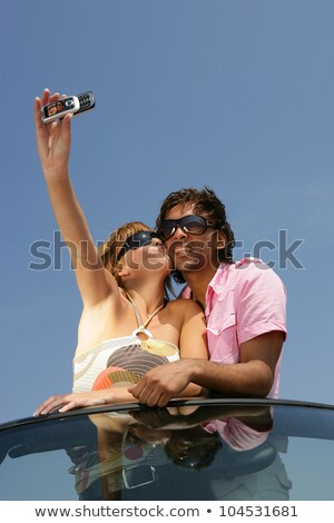 Couple taking a self-portrait with a cameraphone Stock photo © photography33