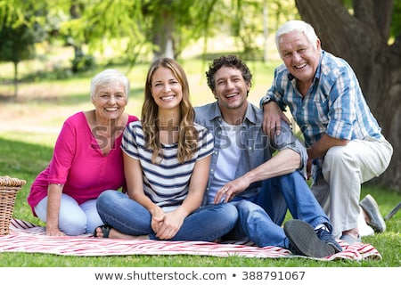 Senior couple  sitting by a tree in the summertime Stock photo © photography33