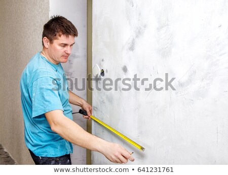 Artisan measuring wallpaper Stock photo © photography33