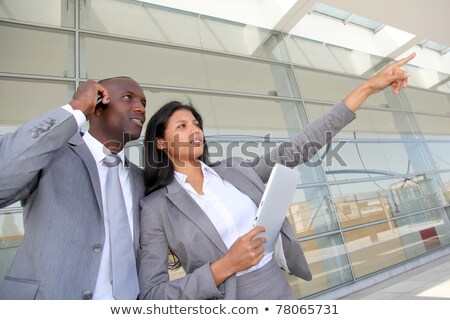 businesswoman on laptop outside airport stock photo © photography33