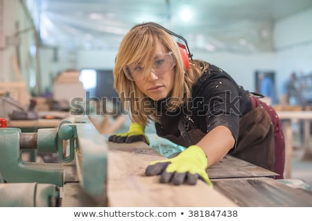 Carpenter using electric sander Stock photo © photography33
