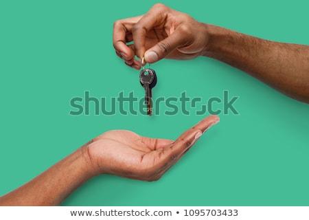 kéz · tart · öreg · kulcsok · klasszikus · fém - stock fotó © taigi