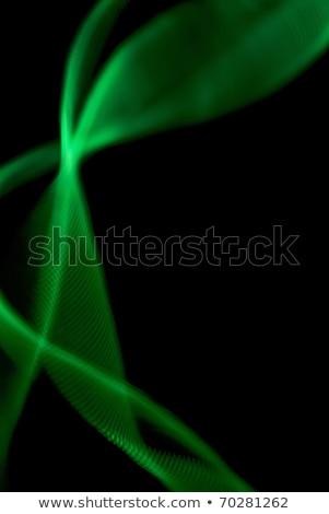 Green light painted streak on a black Stock photo © ozaiachin