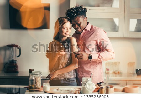 young couple holding eachother by the waist and smiling Stock photo © feedough