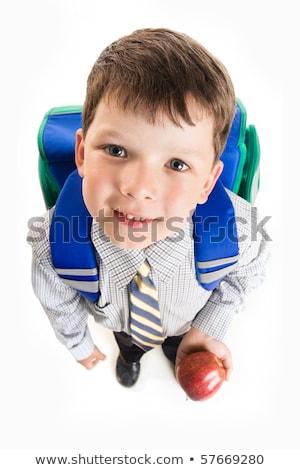 Imádnivaló iskolás fiú alma spanyol fiú iskolai egyenruha Stock fotó © lisafx