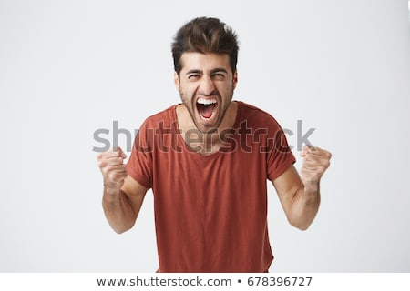 Young man screaming, studio shot stock photo © photography33