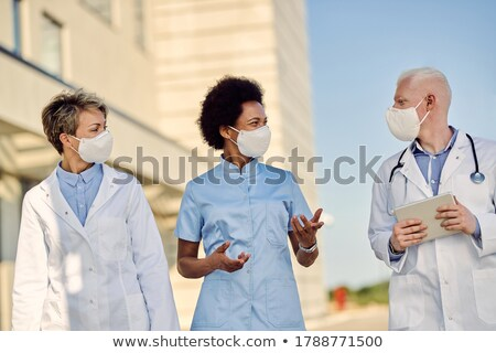 Healthcare worker talking on the phone Stock photo © photography33
