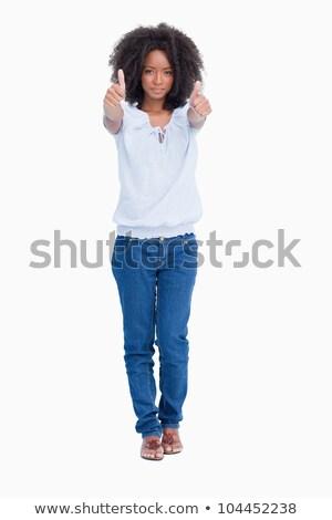 Młoda kobieta poważnie dwa zadowolenie podpisania Zdjęcia stock © wavebreak_media