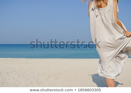 Cropped image of woman body against oceanic background Stock photo © luckyraccoon