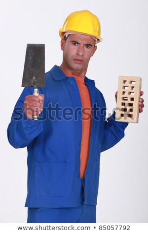 Angry tradesman holding a brick and trowel Stock photo © photography33