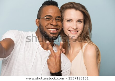 Picture of close-up faces of two lovers Stock photo © konradbak