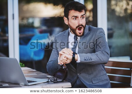 Businessman realizing he is late Stock photo © photography33