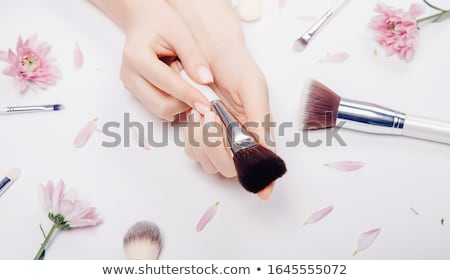 beautiful woman holding makeup brushes set stock photo © chesterf