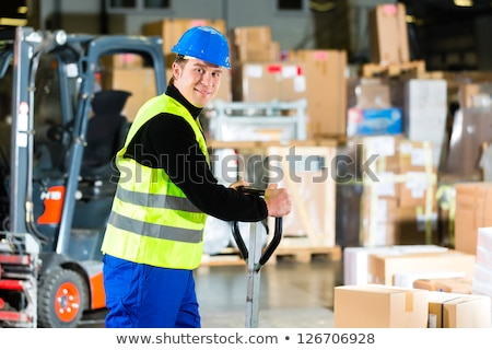 Storeman with mover at warehouse of forwarding Stock photo © Kzenon