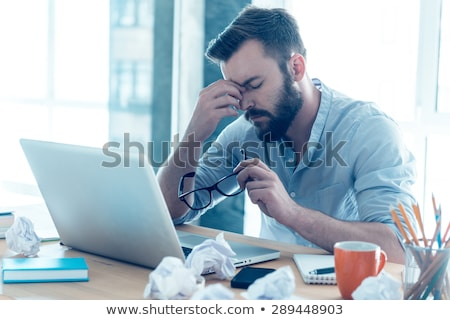 Man frustrated with his laptop computer Stock photo © ashumskiy