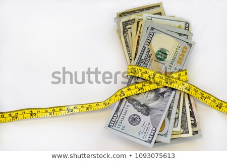 money concept of expensive bill with measurement tape Stock photo © artush