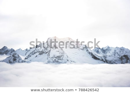 Mountains peak covered with snow. Stock photo © rglinsky77