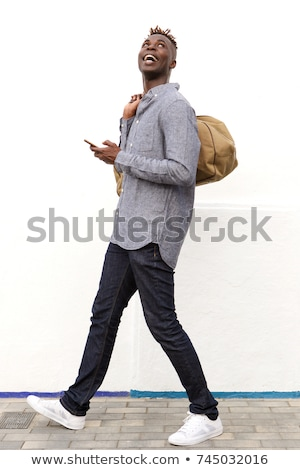 young fashion man looks up the road Stock photo © feedough