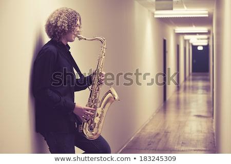 Jóvenes adolescente jugando saxófono foto adolescente Foto stock © sumners