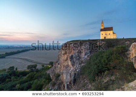 old roman church at sunset in drazovce slovakia stock photo © kayco