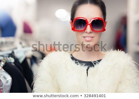 sensueel · blond · meisje · zonnebril · dame · hemel - stockfoto © konradbak