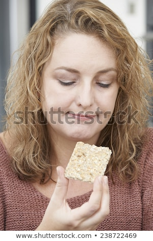 Bored Woman On Diet Eating Crispbread At Home Stock photo © HighwayStarz