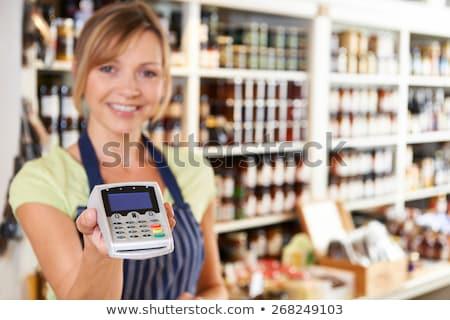 Sales Assistant In Food Store Handing Credit Card Machine To Cus Stock photo © HighwayStarz