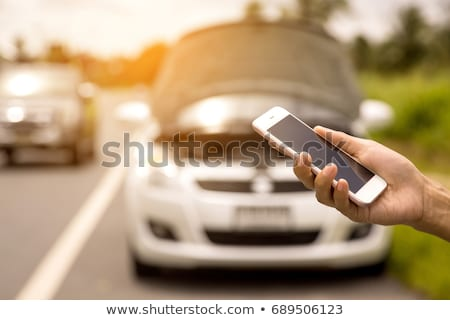 Young woman calling roadside assistance Stock photo © stryjek