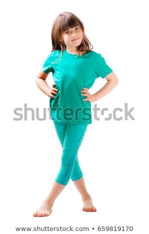 Csinos lány rövidnadrág póló áll kezek Stock fotó © cherezoff