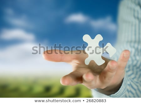 confused businessman holding puzzle pieces stock photo © andreypopov