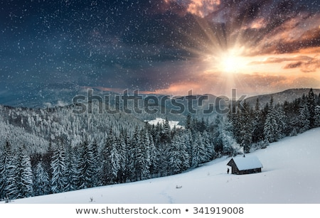 Mountains with snow at evening Stock photo © BSANI