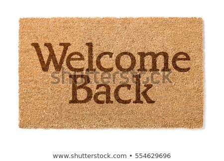 new welcome doormat isolated stock photo © ozaiachin