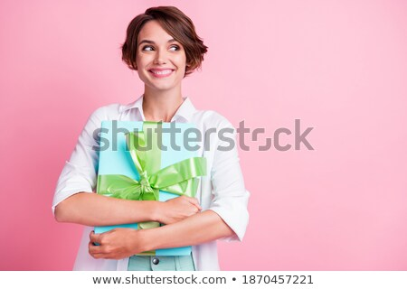 Young nice girl with giftbox isolated on white Stock photo © Elnur