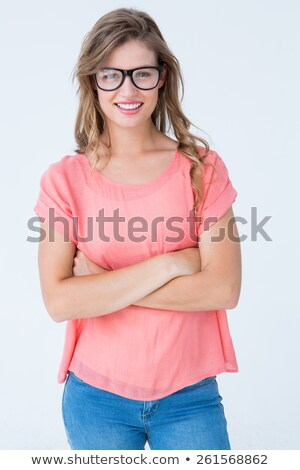 Pretty geeky hipster with arms crossed smiling at camera Stock photo © wavebreak_media