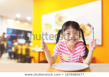 little pretty girl with dishes in hands at restaurant Stock photo © Paha_L
