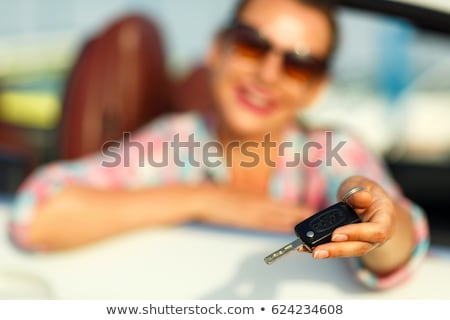 Young pretty woman sitting in a convertible car with the keys in Stock photo © vlad_star