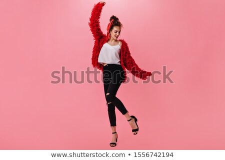 smiling young woman in pink pullover and jeans Stock photo © dolgachov