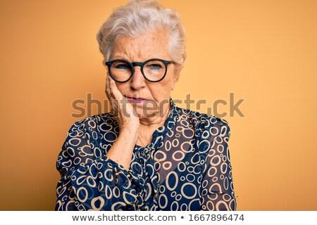 Szomorú zaklatott nő szemüveg áll kezek Stock fotó © deandrobot