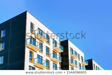 Magas modern társasház külső kék ég város Stock fotó © speedfighter