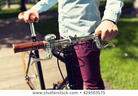 close up of young hipster man with fixed gear bike stock photo © dolgachov