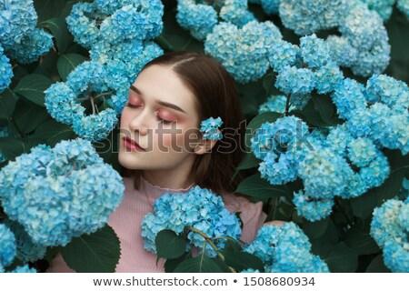 Retrato mulher olhos azuis olhando câmera estúdio Foto stock © feedough