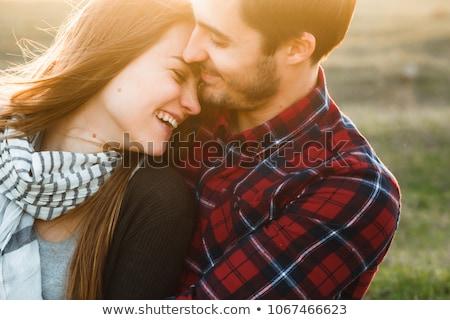 Közelkép portré boldog házaspár ágy otthon Stock fotó © deandrobot
