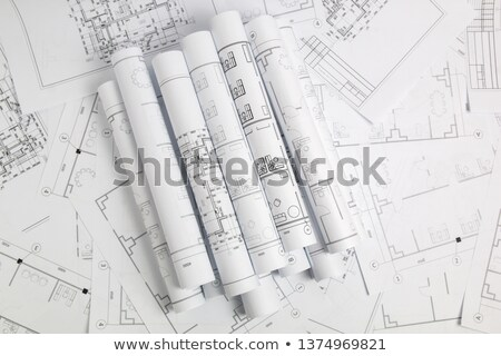 Architectural blueprints and blueprint rolls and a drawing instr stock photo © dfrsce