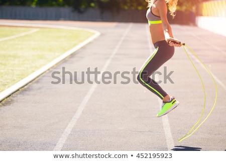 Close up of woman feet jumping, using skipping rope in stadium Stock photo © Yatsenko
